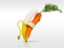 Banana and carrot dancing for health. Eat healthy with fruit and vegetables Stock Photos