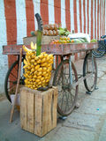 Banana and cart. A fruit cart with bunch of bananas infront of cart Royalty Free Stock Photography