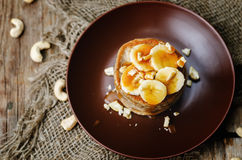 Banana cashew pancakes with bananas and salted caramel sauce Stock Photos