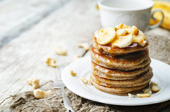 Banana cashew pancakes with bananas and salted caramel sauce Stock Images