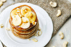 Banana cashew pancakes with bananas and salted caramel sauce Stock Photo