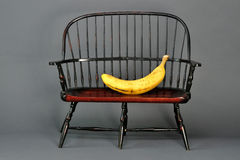 Banana in Chair. A ripe banana in a chair Stock Image