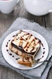 Banana cheesecake with chocolate syrup Stock Image