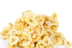 Banana Chips. A pile of dried banana chips, isolated against a white background Royalty Free Stock Image