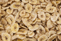 Banana chips. Made from dehydrated slices of fresh ripe bananas Royalty Free Stock Images