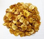 Banana Chips Newly Cooked on White Background stock image
