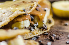Banana And Choco Chips Pancake With Syrup On It Stock Image