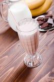 Banana chocolate cocktail behind bananas and chocolate milk Stock Photography