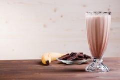 Banana chocolate cocktail behind bananas and chocolate Stock Images