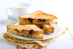 Banana and chocolate grilled sandwiches Stock Photos