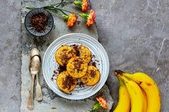 Banana chocolate muffins. Flat-lay of healthy banana chocolate muffins captured from above royalty free stock photos