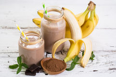 Banana and chocolate smoothie. In the glass jar stock photos