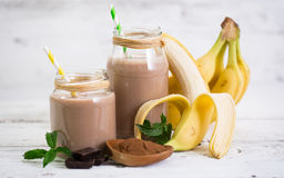 Banana and chocolate smoothie. In the glass jar stock photography