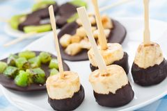 Banana with chocolate on a stick Stock Images