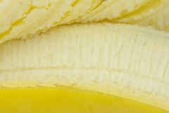 Banana closeup showing endocarp edible part and peeled back skin Royalty Free Stock Images