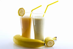 Banana cocktail and banana juice with a straw Stock Image
