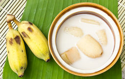 Banana in coconut milk and banana on banana leaves Royalty Free Stock Photo