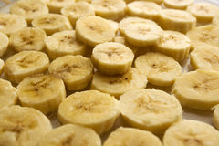 Banana coins. Banana background. Bananas are cut by circles Stock Photo