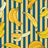 Banana colorida dos desenhos animados Teste padrão sem emenda com as bananas no fundo azul Fotografia de Stock