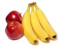 Banana com a maçã vermelha isolada no branco imagens de stock