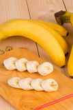 Banana composition on wooden board. Royalty Free Stock Images