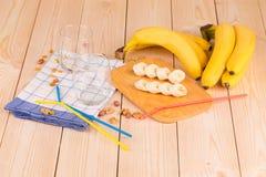 Banana composition on wooden board. Royalty Free Stock Photos
