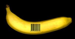 Banana con il codice a barre Fotografie Stock