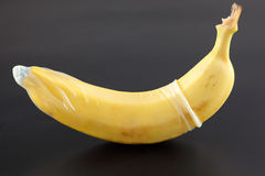 Banana with condom Stock Photography