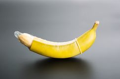 Banana with condom Stock Photo