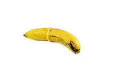 Banana & condom Stock Images