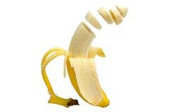 Banana cortada de flutuação Fotografia de Stock