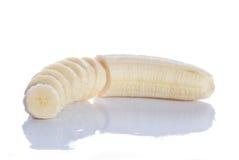 Banana cortada no branco imagens de stock royalty free