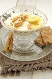 Banana cream. Dessert with cinnamon on a napkin in vertical Royalty Free Stock Photo
