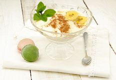 Banana cream. Dessert with cinnamon on a napkin with spoon Stock Images