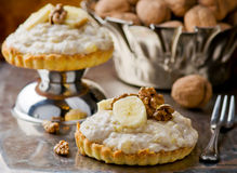 Banana cream cakes and nuts. Stock Image