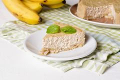 Banana cream pie on a white plate. Close up, horizontal royalty free stock photography