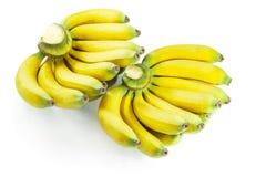 Banana crua isolada no fundo branco Imagem de Stock