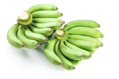 Banana crua isolada no fundo branco Fotografia de Stock Royalty Free