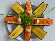 BANANA AND CULINARY DECORATION. These bananas cut to length offers a nice few vegetables decoration company such as onion,parsley,garlics and carrote stock photo