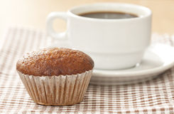 Banana cup cake with black coffee on desk Stock Image