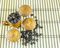 Banana cup cake and coffee beans on wooden background Stock Photography