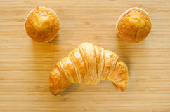 Banana cup cake and croissant Stock Images