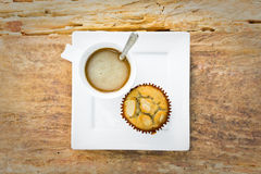 Banana cup cake with hot coffee for relax time Royalty Free Stock Photo