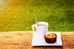 Banana cup cake with hot coffee for relax time Stock Photography