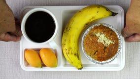 Banana cup cake, ripe banana, marian plum and black coffee.
