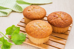 Banana cup cake on wooden plate Stock Images