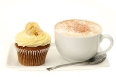 Banana cupcake and a cappuccino Royalty Free Stock Photography