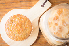 Banana cupcake and iced coffee Stock Images