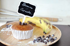 Banana Cupcake on Wooden Plate Background Stock Photo
