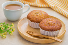 Banana cupcake on wooden plate and cup of coffee Royalty Free Stock Photos